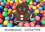 christmas gingerbread man playing with many gumballs - stock photo