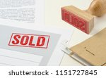 a red stamp on a document   sold | Shutterstock . vector #1151727845