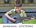 child boy playing on guitar in...   Shutterstock . vector #1151753462