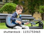 child boy playing on guitar in...   Shutterstock . vector #1151753465