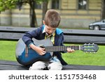 child boy playing on guitar in...   Shutterstock . vector #1151753468