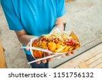 hands of a teenager holding a... | Shutterstock . vector #1151756132