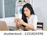 the panic asian woman checking... | Shutterstock . vector #1151824598