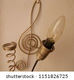 light bulb and it's wires make... | Shutterstock . vector #1151826725
