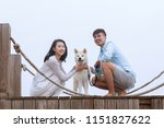 young asian couple on pier with ... | Shutterstock . vector #1151827622