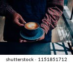 close up man hands holding ... | Shutterstock . vector #1151851712