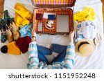 woman sit on bed with suitcase... | Shutterstock . vector #1151952248