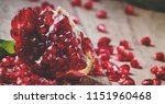 fresh peeled pomegranates with... | Shutterstock . vector #1151960468