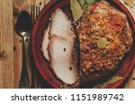 baked ham with spices on a clay ... | Shutterstock . vector #1151989742