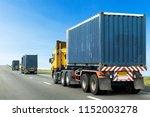 three semi truck on highway... | Shutterstock . vector #1152003278