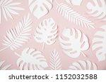 tropical leaves pattern.... | Shutterstock . vector #1152032588