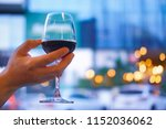 Hand Held A Glass Of Wine Unde...