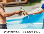 cropped view of couple clinking ... | Shutterstock . vector #1152061472