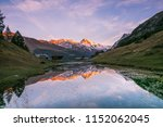 Sunset Over Snowy Mountains An...