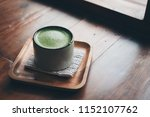 a cup of hot matcha latte on... | Shutterstock . vector #1152107762