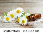 small glass bottle with... | Shutterstock . vector #1152116435