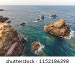rocks and waves and splashes in ... | Shutterstock . vector #1152186398
