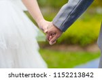 young married couple holding... | Shutterstock . vector #1152213842