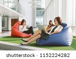 group of three young using... | Shutterstock . vector #1152224282