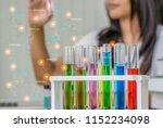 young woman chemist work... | Shutterstock . vector #1152234098