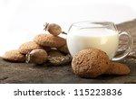 oatmeal cookies and a mug of milk - stock photo
