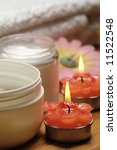 bath towel and aromatic candles and cream - stock photo