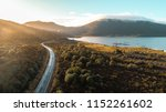 Aerial View over blue lake and green mountain at sunrise. Road to mountain along Lake Rotoaira ,North island ,New Zealand