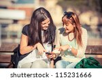 two young women with mobile... | Shutterstock . vector #115231666