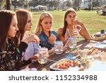 group of happy girlfriends... | Shutterstock . vector #1152334988