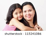 Close up picture of mother and daughter. - stock photo
