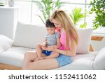 mommy use phone with son on... | Shutterstock . vector #1152411062