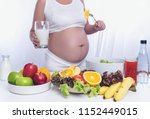 pregnant woman is cooking fruit ... | Shutterstock . vector #1152449015