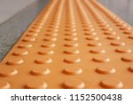 tactile paving  is a system of... | Shutterstock . vector #1152500438