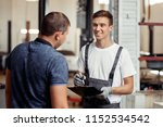 an attractive automechanic is... | Shutterstock . vector #1152534542
