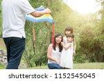 asian family outdoors activity. ... | Shutterstock . vector #1152545045