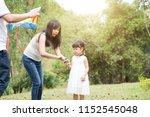 asian family outdoors activity. ... | Shutterstock . vector #1152545048