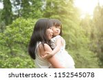 asian family outdoors portrait. ... | Shutterstock . vector #1152545078