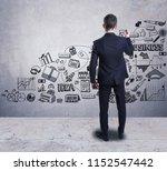 a businessman drawing a... | Shutterstock . vector #1152547442