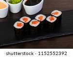 appetizing sushi roll with red... | Shutterstock . vector #1152552392