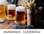 light foam beer in a glass on... | Shutterstock . vector #1152560312