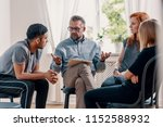 counselor talking to a group of ... | Shutterstock . vector #1152588932