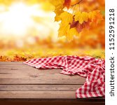 red checkered tablecloth on... | Shutterstock . vector #1152591218