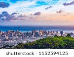 Small photo of Cityscape of Honolulu city and Waikiki beach with blue sky , ocean and light reflection from sunset sky to buildings from Ualaka'a lookout on Tantalus mountain in Honolulu, Oahu, Hawaii USA