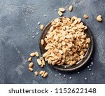 salted roasted peanuts seeds on ... | Shutterstock . vector #1152622148