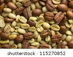 green and roasted coffee beans background - stock photo