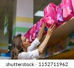 mother chooses a pink school... | Shutterstock . vector #1152711962