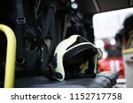 photo of fireman's black hat | Shutterstock . vector #1152717758