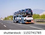 cars carrier in the road. truck ... | Shutterstock . vector #1152741785