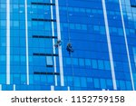 two workers washing windows of... | Shutterstock . vector #1152759158