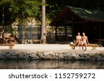 active couple rests on river... | Shutterstock . vector #1152759272